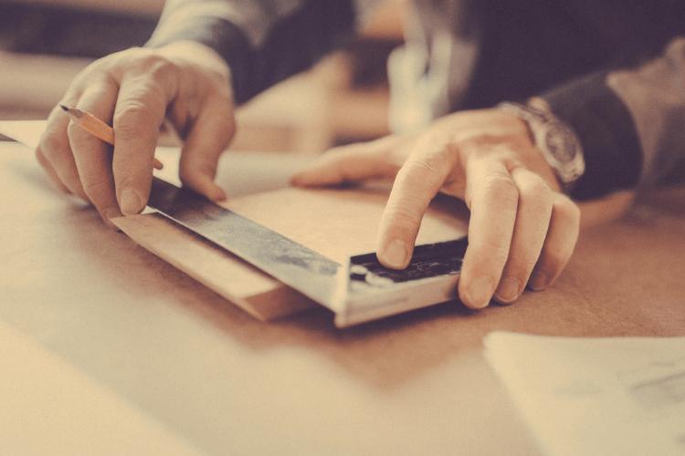 carpenters using best framing square